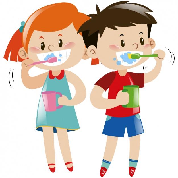 ninos-lavandose-los-dientes_1308-129